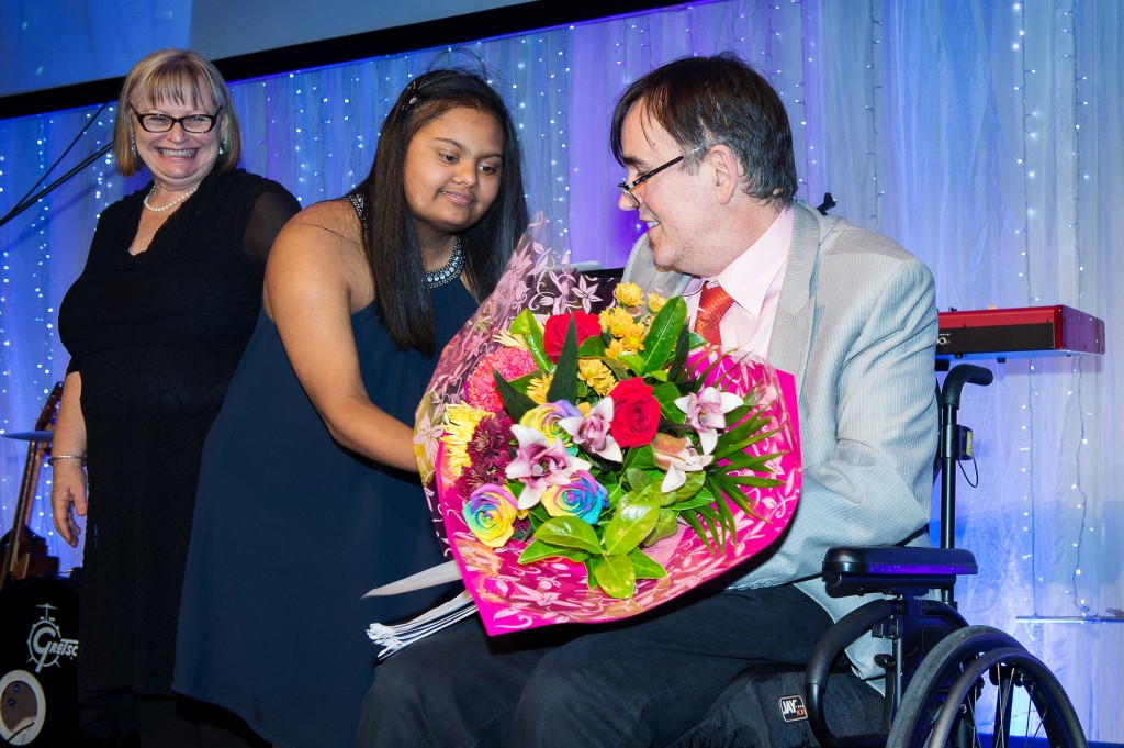 Tim Ferguson is presented with flowers by Gayana of GG's Flowers