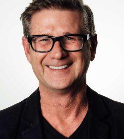 smiling man wearing stylish glasses