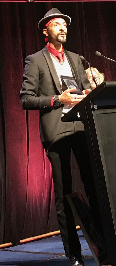 Anton accepting award